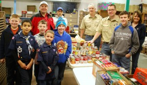Photo of a group of boy scouts and their leaders who volunteer at The Lord's Pantry at Anna's House.